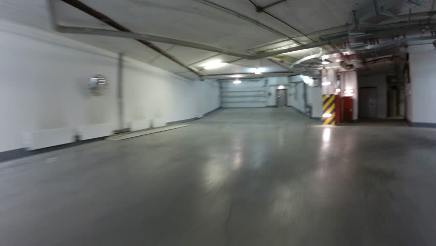 Underground Residential Garage #25: Departure From The Underground Car Park On A Bicycle In A Residential Area. Time Lapse