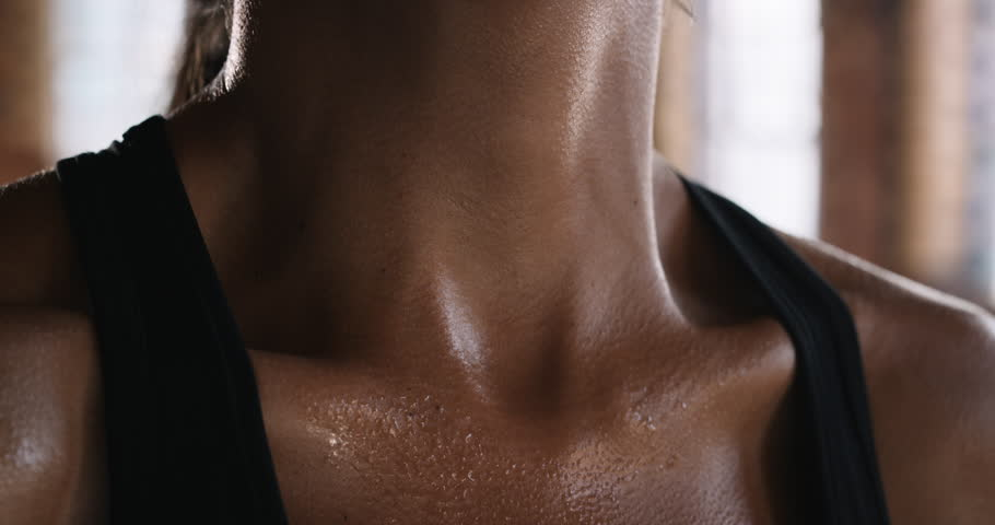 Close up crop of beautiful women fit body fitness studio fierce strength slow motion kickboxer series