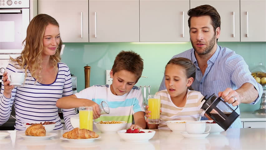 family eating breakfast - 852×480