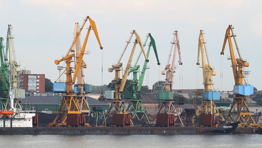 working cranes at port