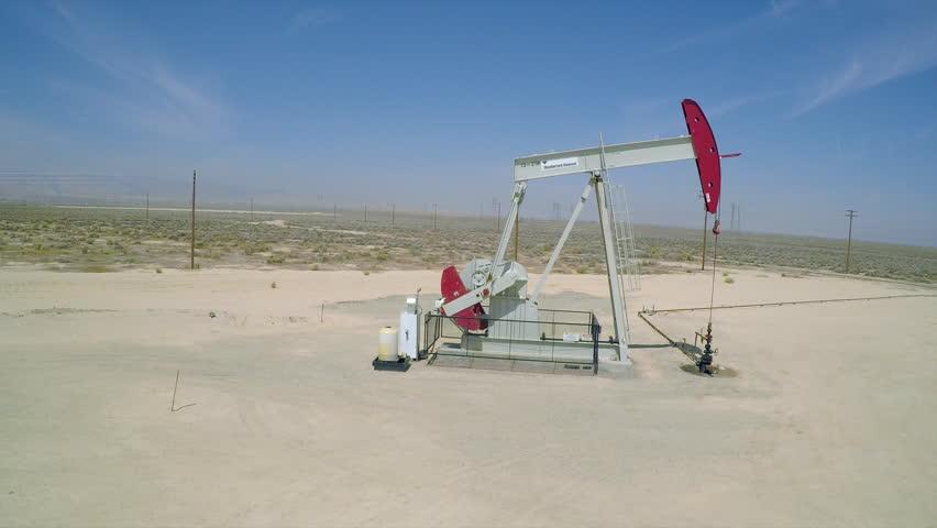 BAKERSFIELD, CALIFORNIA - CIRCA 2015 - A good aerial shot beside an oil pumping derrick near Bakersfield, California. | Shutterstock HD Video #13070978