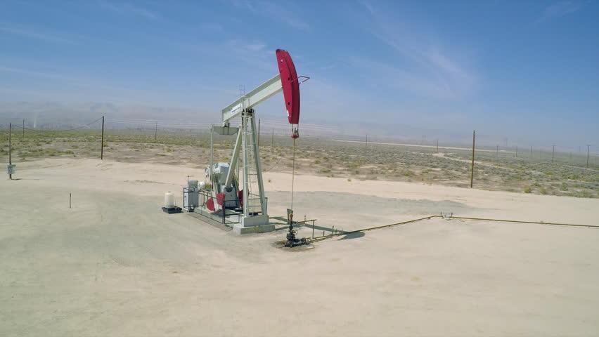 BAKERSFIELD, CALIFORNIA - CIRCA 2015 - A good aerial shot over an oil pumping derrick near Bakersfield, California. | Shutterstock HD Video #13071014