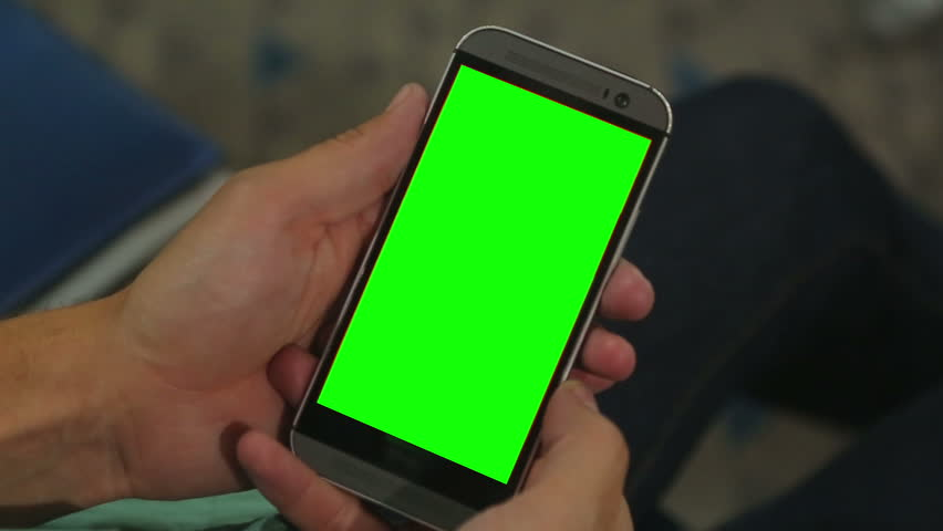 Closeup of male hands holding smart phone with green screen prekeyed for effects   Shutterstock HD Video #13262075