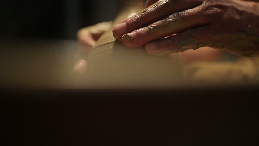 Potter special tools handles clay. Master crock. The creative process in the studio. Twisted potter's wheel. Man creates a work of art. The ability to create beauty. Master kneads the clay.  | Shutterstock HD Video #13264115