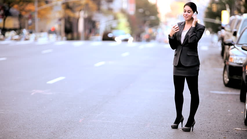 Smart young businesswoman talking on a cell phone on the streets of New York | Shutterstock HD Video #1334593