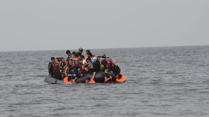 LESVOS, GREECE October 25, 2015: Refugees arriving in Greece in dinghy boat from Turkey. These Syrian, Afghanistan and African refugees land their boat at the North coast of Lesvos near Molyvos.