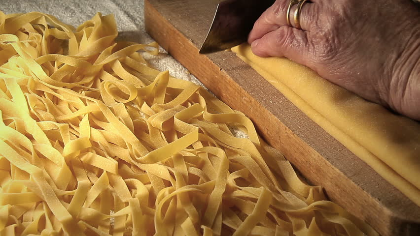 Cutting Raw And Long Tagliatelle Pasta: Handmade Spaghetti, Fresh ...