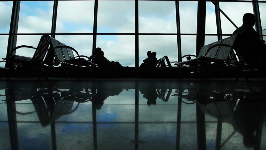 People silhouettes walking at airport space