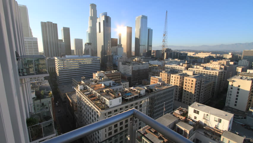 Gorgeous Forward-Sliding Timelapse above Balcony Railing onto Downtown Los Angeles during Nightfall (camera slides forward for the first 9 seconds then stays steady) | Shutterstock HD Video #1367191