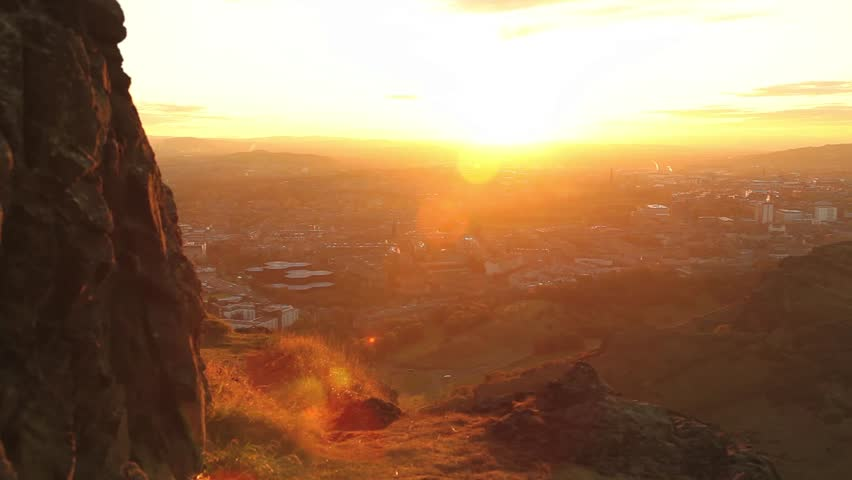 Edinburgh Scotland sits at the bottom of a beautiful green hill at sunset. | Shutterstock HD Video #13786781