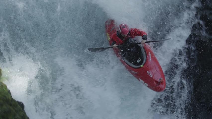 WS TD Man kayaking through extreme rapids