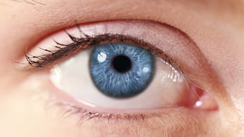 Network. Eye. Blue. Zoom in from a blue human eye to a network animation. Technology background.