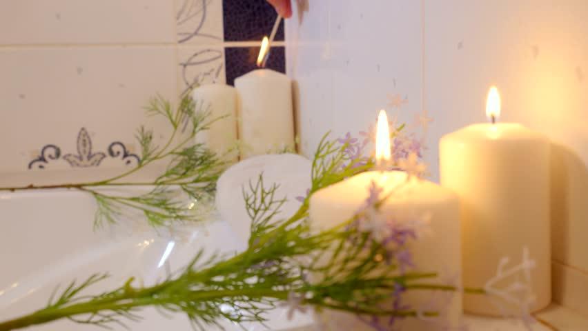 Women Hand Burns Candles In Bathroom Spa Still Life 4k Stock Footage Clip