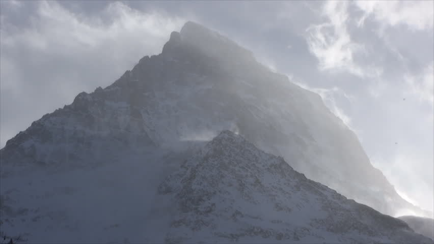 Close Up Of Snow Mountain Summit And Fast Moving Clouds Stock ...