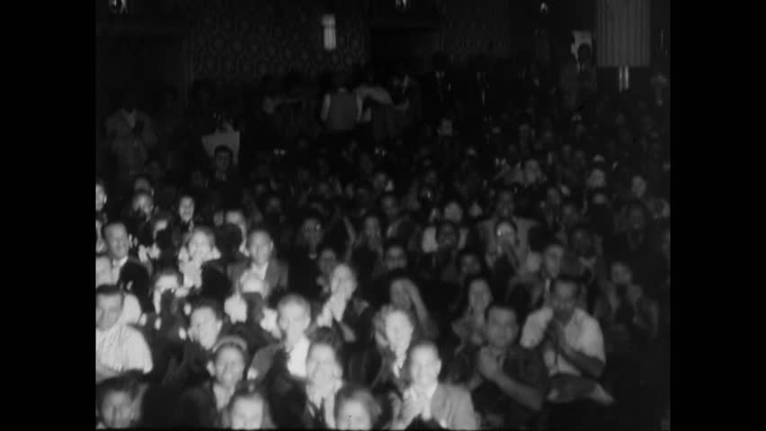 Montage of audience in theater clapping, 1950s