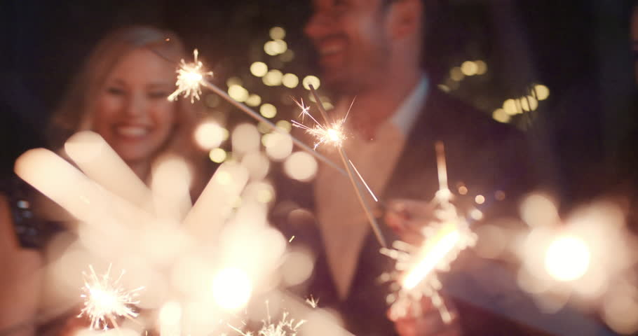 Sexy happy group of friends at glamorous party lighting sparklers having fun smiling celebrating new year's eve. | Shutterstock Video #14075948