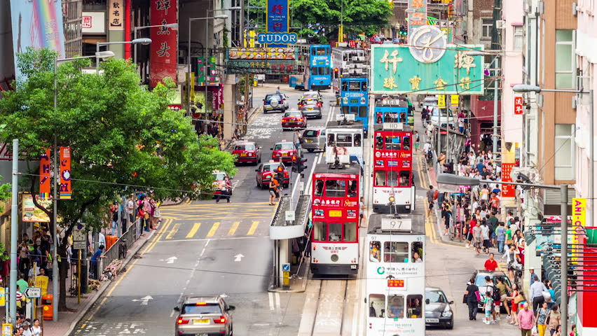HONG KONG - 10 SEPT 2013: Timelapse view of people and traffic on the streets Hong Kong city at Central. Hong Kong is a major financial hub in the Asia region on 10 September 2013 in Hong Kong, China | Shutterstock HD Video #14089484