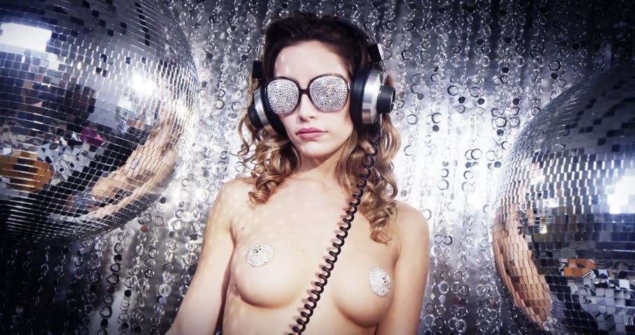 stunning sexy disco woman with silver nipple tassles surrounded by disco balls