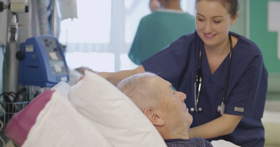 4k / Ultra HD version A beautiful female nurse attends to an elderly male patient, plumping up his pillows and chatting with him. Shot on RED Epic   Shutterstock HD Video #14129882