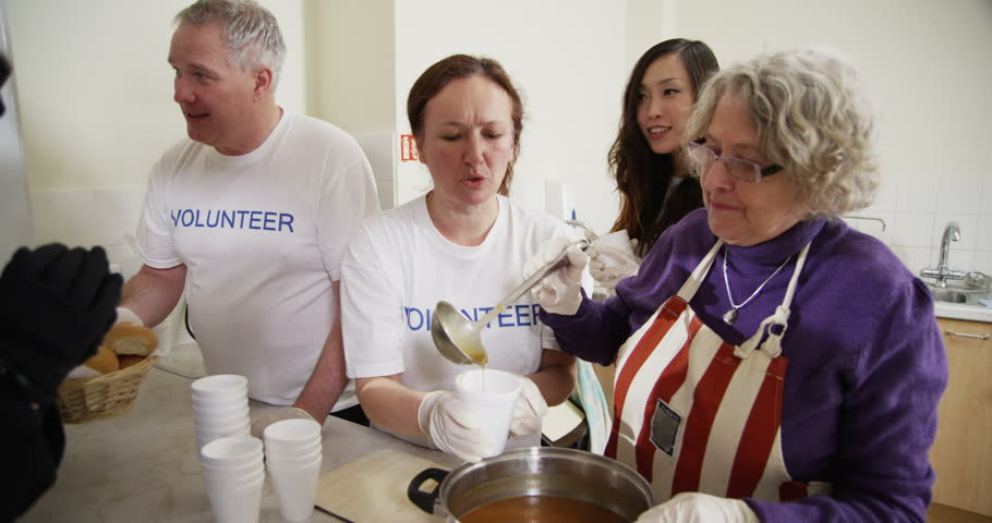 amazing How To Volunteer At A Soup Kitchen #9: 4k / Ultra HD version Friendly soup kitchen volunteers of mixed ages and ethnicity are serving