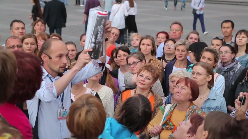 MOSCOW, RUSSIA – August 17, 2015: The guided tour near the Kremlin (sunset) #14222993