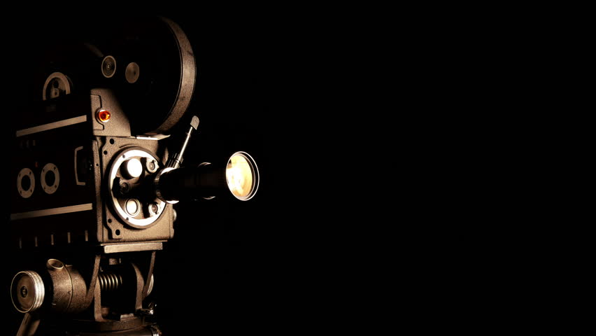 vintage hollywood movie camera and theater stage spotlight