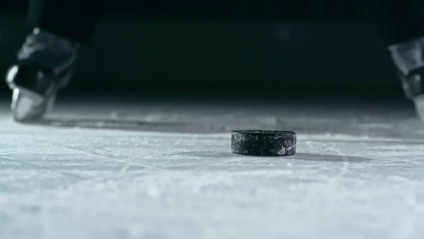 Close-up of hockey puck being struck by hockey player in slow motion   Shutterstock Video #14497141