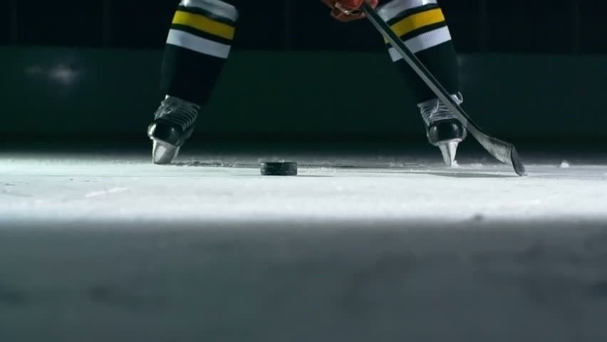 Closeup of hockey player slapping a puck with his stick in slow motion    Shutterstock Video #14497159