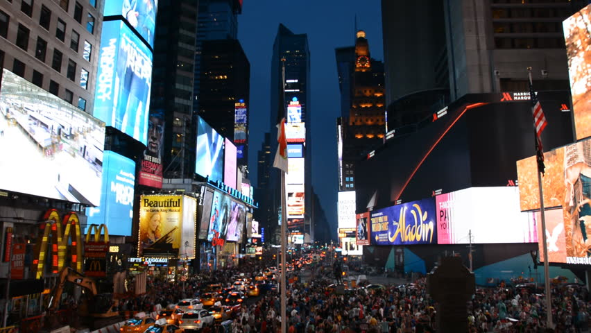 NEW YORK CITY, USA - JULY 25, 2015 New York City Times Square Wide Shot Nightlife People Walking Cars Busy Area | Shutterstock HD Video #14625886