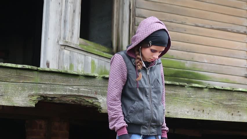 Sad Teen Girl With Earphones And Hoodie Standing On Train -1997