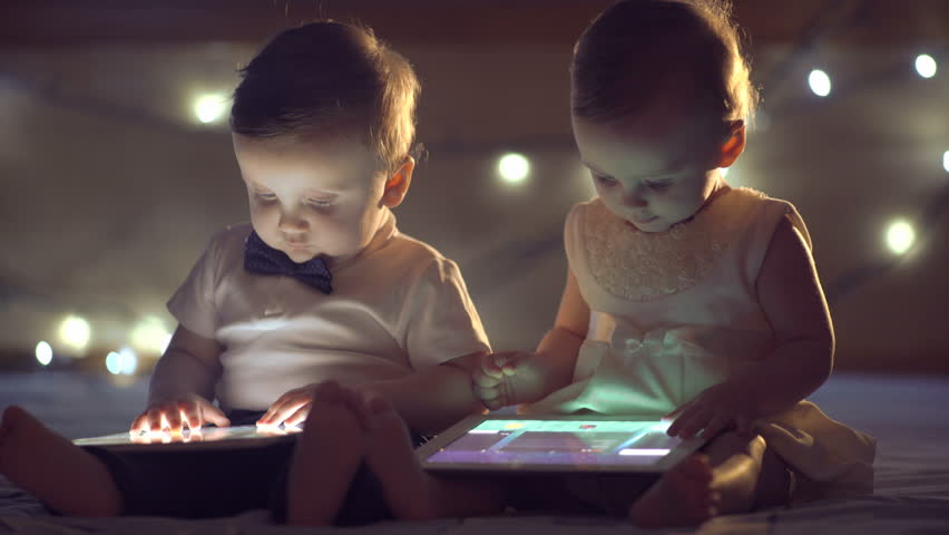 Two children playing with a tablet