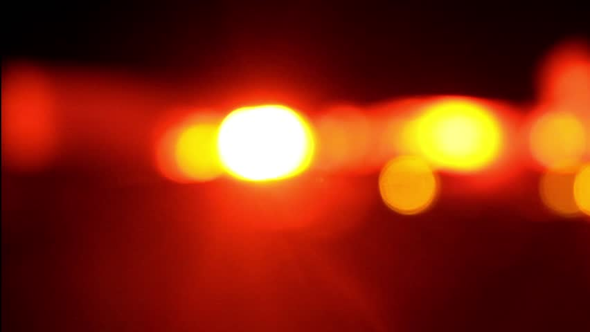 Emergency flashing lights night scene. Seamlessly loopable video.