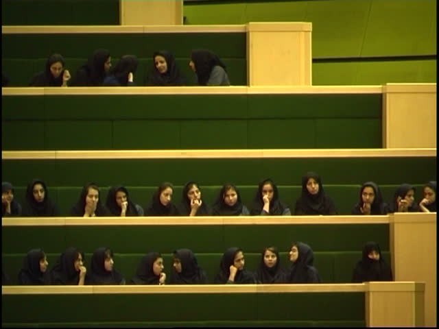 Parliament, Tehran, Iran - 2005 - Young Iranian girls sit in the public gallery of the Iranian Parliament. All the girls are wearing grey uniforms and dark blue veils.