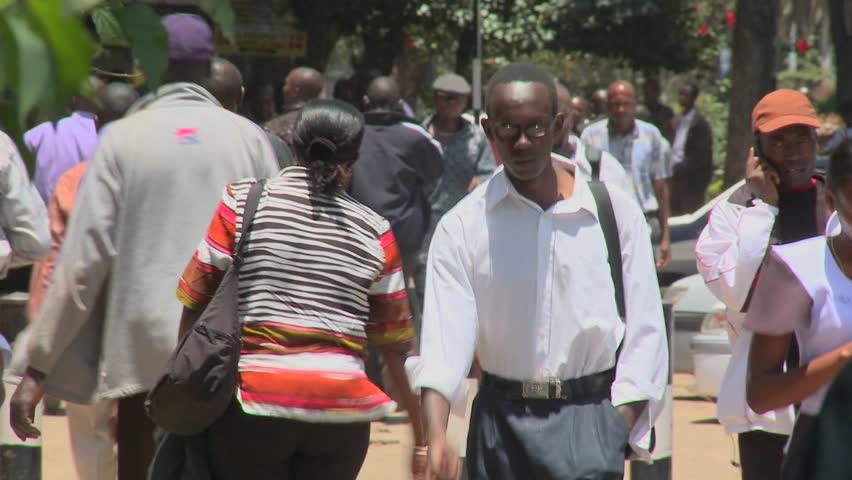 NAIROBI, KENYA - CIRCA 2009:  Pedestrians walk on the streets circa 2009 in Nairobi, Kenia.