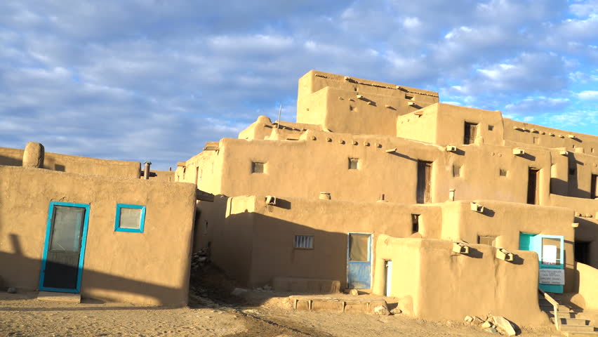 Footage with pan right / zoom out motion of traditional Native American houses in Taos Pueblo, New Mexico