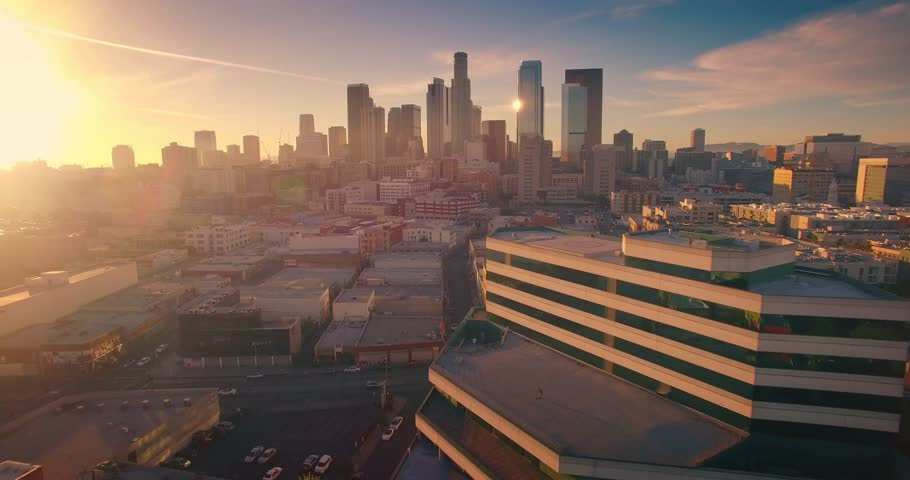 Aerial view of city of Los Angeles downtown skyline at sunset. Camera flying forward. 4K UHD. | Shutterstock HD Video #14914309