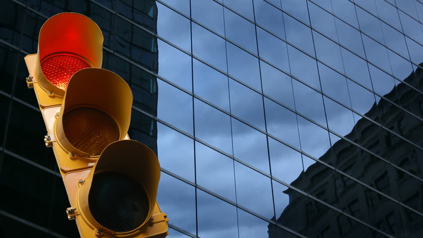 Stoplight in a city environment goes from green to yellow to red