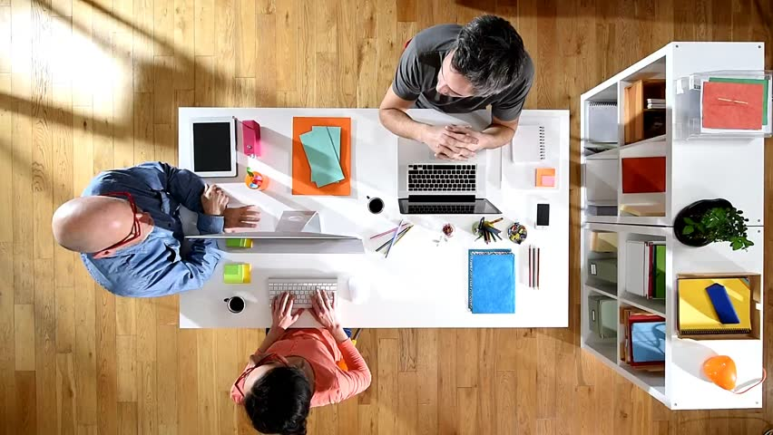 Top view. Brainstorming for creative team sitting together around a table in the office to discuss a project | Shutterstock HD Video #15049549