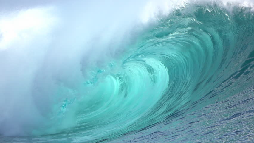 SLOW MOTION CLOSE UP: Big powerful Teahupoo tube wave breaking and splashing over the island reef, water drops spraying in the wind in sunny summer | Shutterstock HD Video #15054655