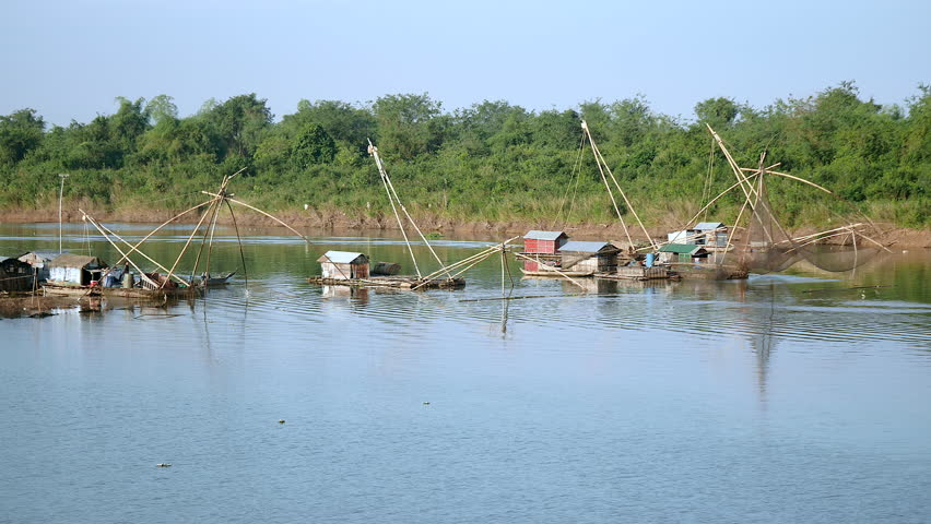 Houseboats And Chinese Fishing Nets On River; Fisherman Lifting ...