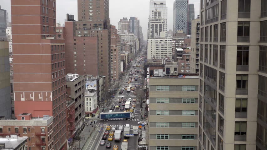 NEW YORK - MARCH 10, 2016: aerial view busy Manhattan street with truck causing holdup in NYC. Traffic is a major problem in the city, as the number of automobiles increases each year.   Shutterstock HD Video #15166129