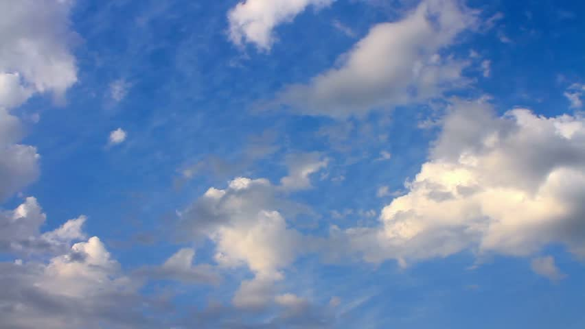 Fleeing clouds on the blue sky. 30sec, 30 fps footage of HD timelapse cloudscape. Cumulus clouds form against a brilliant blue sky. Timelapse of beautiful white clouds with blue sky in background