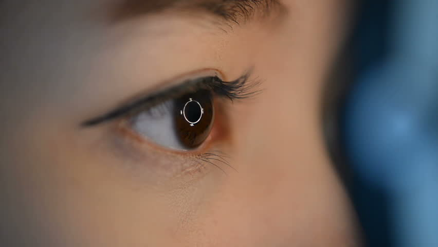 Close up woman's eyes with eye test machine in ophthalmologist.    Shutterstock HD Video #15341248