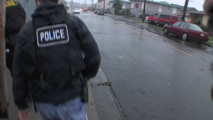 SAN FRANCISCO, CA - CIRCA 2009: A SWAT team of DEA agents raid a crack house circa 2009 in San Francisco.