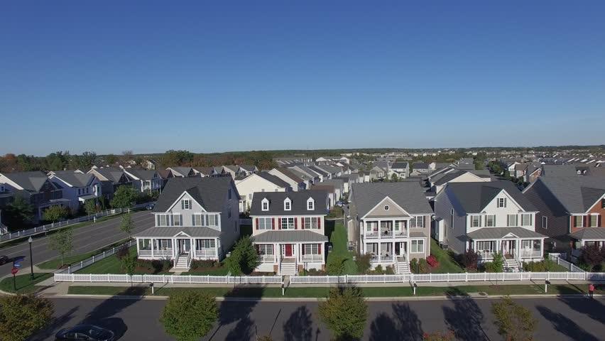 An aerial establishing video of a suburban neighborhood, 4K UHD | Shutterstock HD Video #15529465