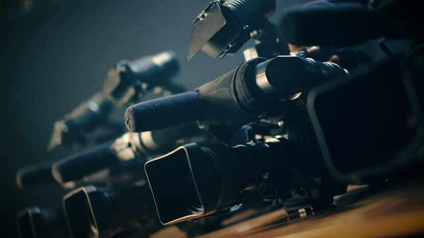 Cameraman prepares his professional  video camera for an urgent, rapid shooting | Shutterstock HD Video #15544885