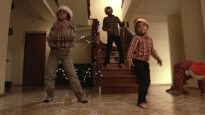 Kids in Santa hats dancing. Children dance freely on Christmas. Good way to express feelings. Time for a holiday dance. | Shutterstock HD Video #15588367