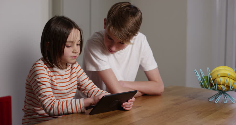 Elder Brother Teaching Few Tricks To His Younger Brother On A Digital Touchscreen -4210