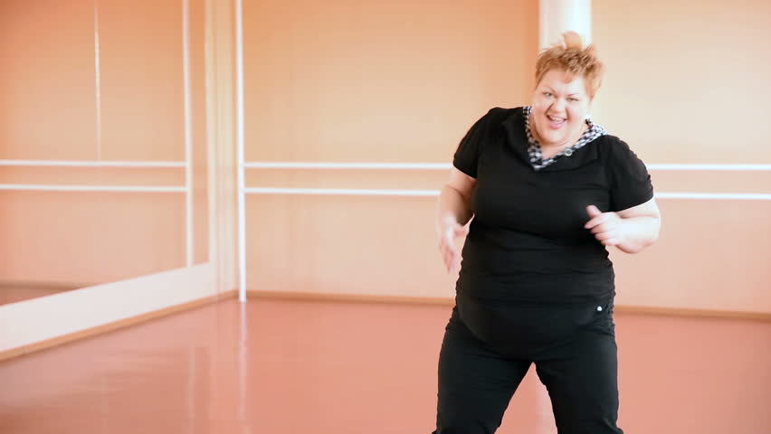 Overweight girl is engaged in dances in the hall. cheerful plump, gymnastics and dance | Shutterstock HD Video #15611131