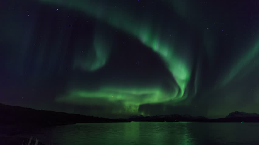 Northern light (aurora borealis) in a fjord 4K | Shutterstock HD Video #15667927